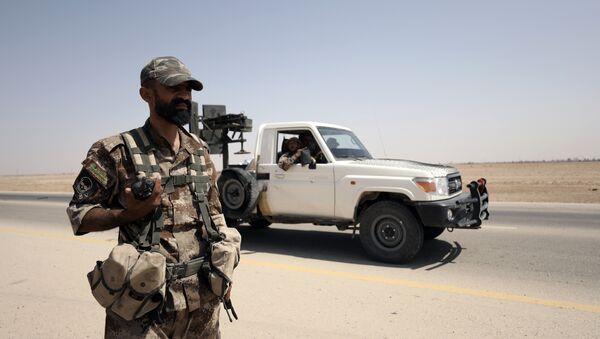 A fighter of Syrian Democratic Forces (SDF) is seen in the eastern Deir al Zor, Syria September 12, 2017 - Sputnik International