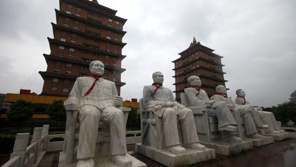 This Aug. 10, 2009 photo shows statues of Deng Xiaoping, Zhou Enlai, Mao Zedong, Zhu De and Liu Shaoqi in front of traditional pagoda-like buildings at Happiness Garden Monday in Huaxi, Jiangsu Province, China - Sputnik International
