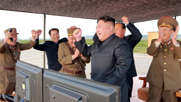 North Korean leader Kim Jong Un guides the launch of a Hwasong-12 missile in this undated photo released by North Korea's Korean Central News Agency (KCNA) on September 16, 2017 - Sputnik International
