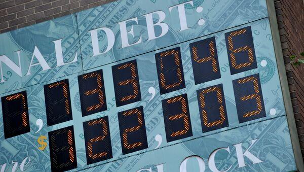 (File) Detail of the National Debt Clock, a billboard-size digital display showing the increasing US debt, on Sixth Avenue August 1, 2011 in New York - Sputnik International