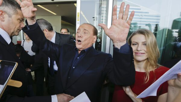 In this file photo taken on July 3, 2015, AC Milan president Silvio Berlusconi waves to supporters flanked by his daughter Barbara, outside the Milanese soccer club's headquarters, in Milan, Italy. - Sputnik International