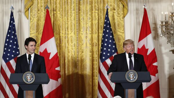 President Donald Trump and Canadian Prime Minister Justin Trudeau participate in a joint news conference in the East Room of the White House in Washington, Monday, Feb. 13, 2017. - Sputnik International