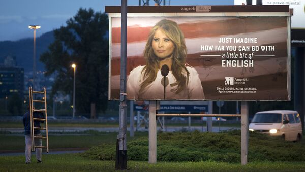 A worker carrying a ladder walks past a billboard depicting the first lady Melania Trump and advertising a language school displayed in Zagreb, Croatia, Friday, Sept. 15, 2017. - Sputnik International