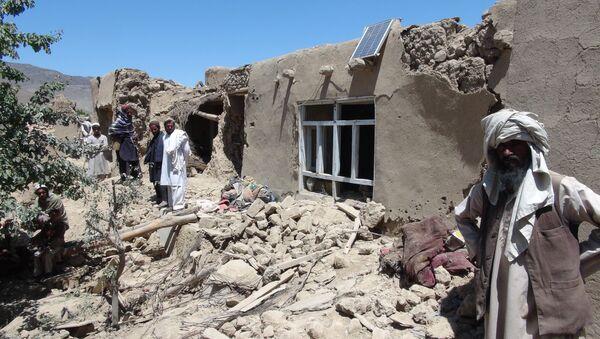 Afghan villagers gather near a destroyed house in Logar province, south of Kabul, Afghanistan (File) - Sputnik International