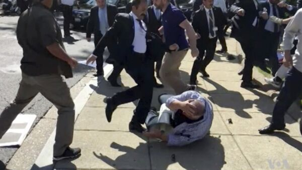 FILE- In this file frame grab from video provided by Voice of America, members of Turkish President Recep Tayyip Erdogan's security detail are shown violently reacting to peaceful protesters during Erdogan's trip last month to Washington - Sputnik International