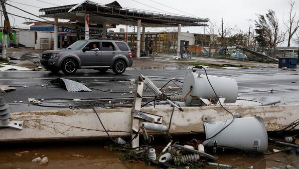 Damaged electrical installations are seen after the area was hit by Hurricane Maria en Guayama, Puerto Rico September 20, 2017 - Sputnik International