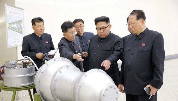 This undated file photo distributed on Sunday, Sept. 3, 2017, by the North Korean government, shows North Korean leader Kim Jong Un, second from right, at an undisclosed location in North Korea - Sputnik International