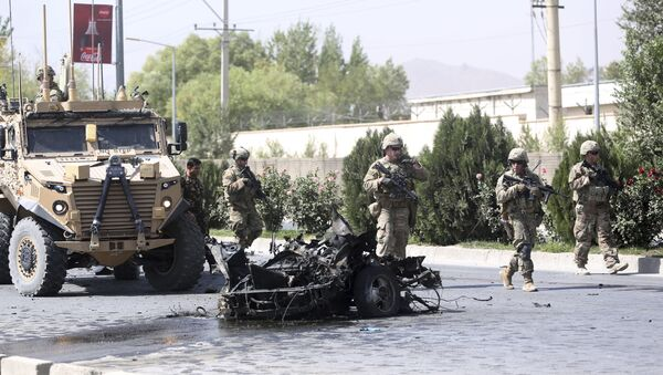 U.S. and Afghan security forces inspect the site of a suicide attack on NATO convoy in Kabul, Afghanistan, Sunday, Sept. 24, 2017 - Sputnik International