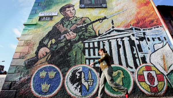 An Irish Republic Army (IRA) mural on a wall in west Belfast, Northern Ireland, Wednesday, Oct. 4, 2006. - Sputnik International
