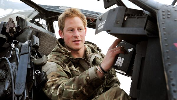 In this photo taken Dec. 12, 2012, made available Monday Jan. 21, 2013 of Britain's Prince Harry or just plain Captain Wales as he is known in the British Army, makes his early morning pre-flight checks on the flight-line, from Camp Bastion southern Afghanistan. - Sputnik International
