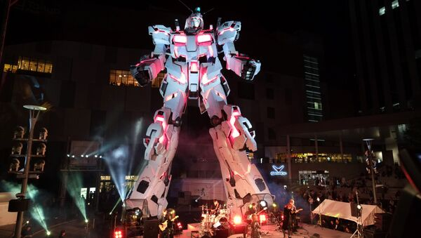 The new full-size standing statue RX-0 Unicorn Gundam from the Mobile Suit Gundam UC anime is unveiled at a press preview in Tokyo - Sputnik International