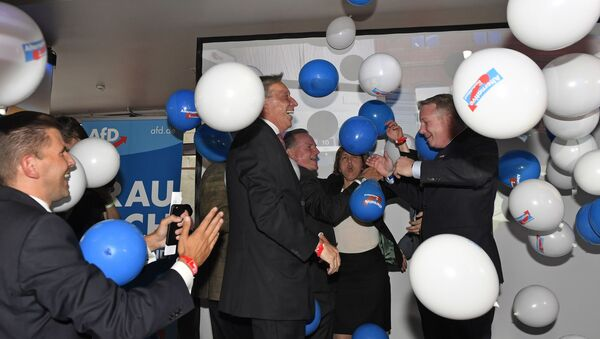AfD board members celebrate with balloons during the election party of the nationalist 'Alternative for Germany', AfD, in Berlin, Germany, Sunday, Sept. 24, 2017, after the polling stations for the German parliament elections had been closed. - Sputnik International