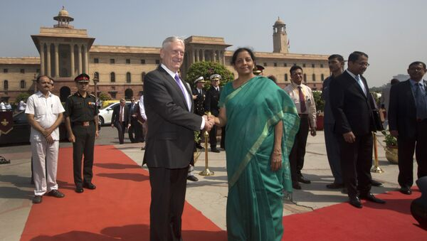 Indian Defense Minister Nirmala Sitharaman, center right, shakes hands with U.S. Defense Secretary Jim Mattis center, upon his arrival at the Defense Ministry office, in New Delhi, India, Tuesday, Sept. 26, 2017 - Sputnik International