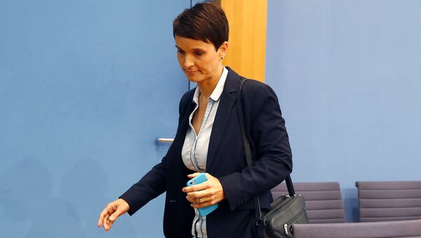 Frauke Petry, chairwoman of the anti-immigration party Alternative fuer Deutschland (AfD) leaves a news conference in Berlin, Germany - Sputnik International