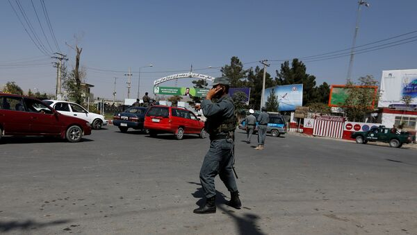 Afghan policemen stand guard outside of Kabul Airport after rockets exploded in Kabul, Afghanistan - Sputnik International