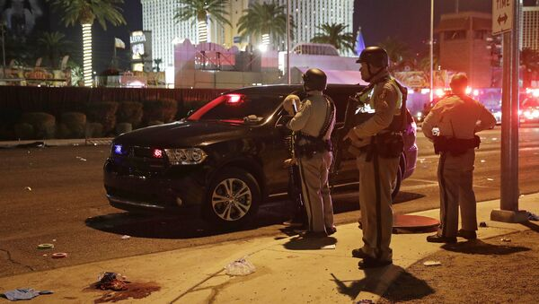 Police stand at the scene of a shooting along the Las Vegas Strip, Monday, Oct. 2, 2017, in Las Vegas - Sputnik International