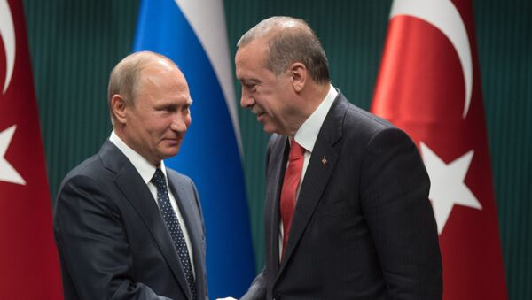 Russian President Vladimir Putin and Turkish President Recep Tayyip Erdogan, right, at a news conference following the Russian-Turkish talks in Ankara - Sputnik International