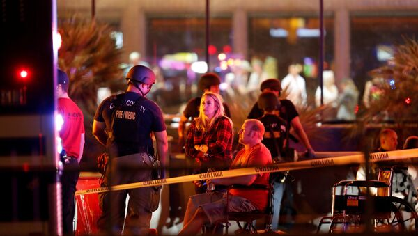 People wait in a medical staging area on October 2, 2017, after a mass shooting during a music festival in Las Vegas, Nevada, U.S - Sputnik International