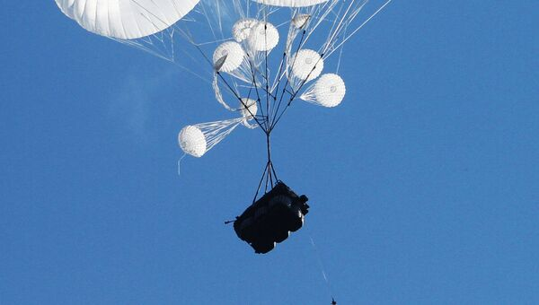 Airborne combat vehicles air dropped during the joint battalion tactical exercise of airborne troops from Russia, Belarus and Serbia at Rayevsky military base outside Novorossiysk - Sputnik International