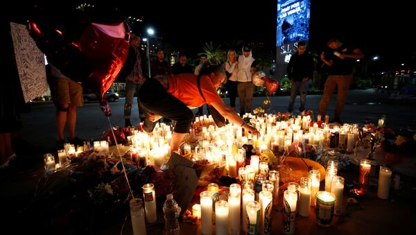 People gather at a vigil on the Las Vegas strip following a mass shooting at the Route 91 Harvest Country Music Festival in Las Vegas, Nevada, U.S., October 3, 2017 - Sputnik International