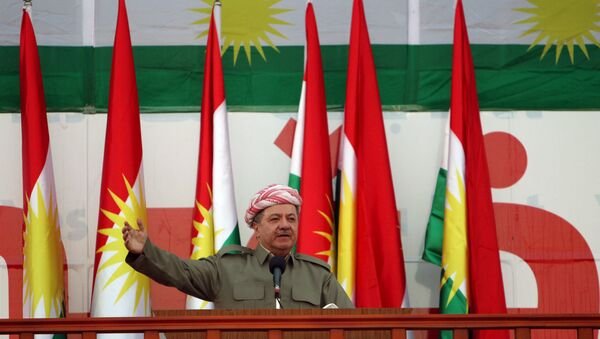 Iraqi Kurdish president Masoud Barzani salutes the crowd while attending a rally that shows the support for the upcoming September 25th independence referendum in Erbil, Iraq September 22, 2017. - Sputnik International