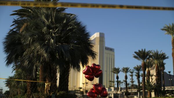 A makeshift memorial is seen next to the site of the Route 91 music festival mass shooting outside the Mandalay Bay Resort and Casino in Las Vegas, Nevada, U.S - Sputnik International