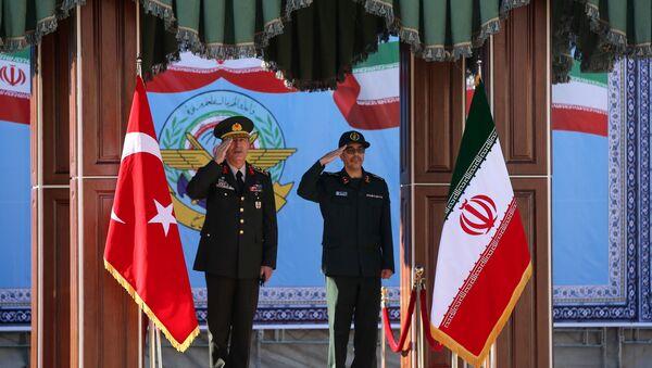 Turkish Chief of Staff General Hulusi Akar meets with his Iranian counterpart Major General Mohammad Baqeri in Tehran, Iran, October 2, 2017 - Sputnik International