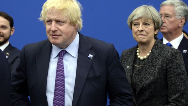 British Foreign Secretary Boris Johnson, left and Britain's Prime Minister Theresa May arrive for a meeting during the NATO summit of heads of state and government, at the NATO headquarters, in Brussels on Thursday, May 25, 2017. - Sputnik International