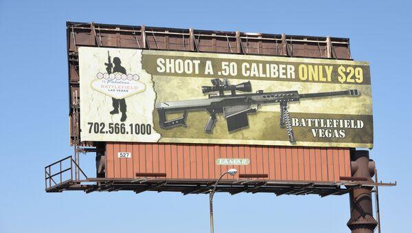 A billboard advertises a gun shooting range in Las Vegas, Nevada on October 4, 2017 - Sputnik International