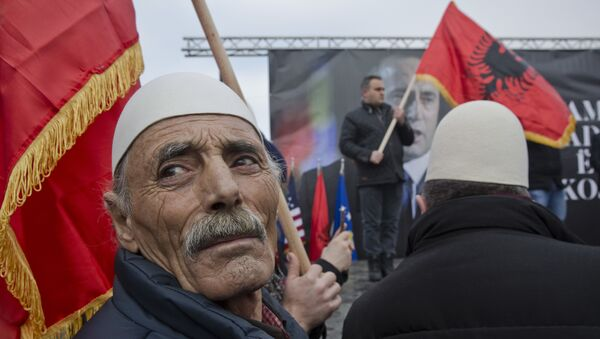 Protesters waving an Albanian flag looks on during a protest demanding immediate release from French judicial supervision of Ramush Haradinaj, Kosovo's former prime minister and a former guerrilla fighter, in Kosovo's capital Pristina on Saturday, Jan 21, 2017 - Sputnik International