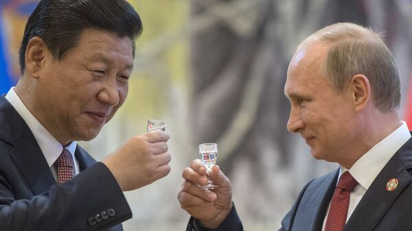 May 21, 2014. President Vladimir Putin, right, and Chinese leader Xi Jinping after the signing of joint agreements in Shanghai - Sputnik International