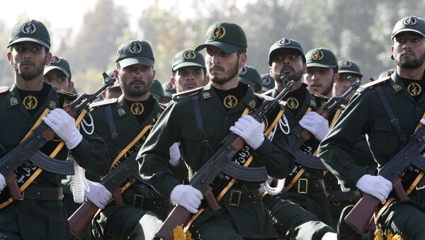In this picture taken on Sunday, Sept. 21, 2008, Iranian Revolutionary Guards members march during a parade ceremony, marking the 28th anniversary of the onset of the Iran-Iraq war (1980-1988), in front of the mausoleum of the late revolutionary founder Ayatollah Ruhollah Khomeini, just outside Tehran, Iran - Sputnik International