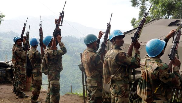 Indian soldiers, serving in the U.N. peacekeeping mission in Congo (MONUSCO), hold up their weapons at their base after patrolling the villages in Masisi, 88 km (55 miles) northwest of Goma, Congo on October 4, 2013 - Sputnik International