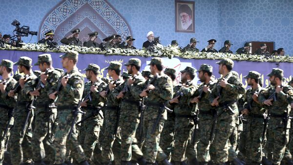 Iran's President Hassan Rouhani, top center, reviews army troops marching during the 37th anniversary of Iraq's 1980 invasion of Iran, in front of the shrine of the late revolutionary founder, Ayatollah Khomeini, just outside Tehran, Iran, Friday, Sept. 22, 2017 - Sputnik International
