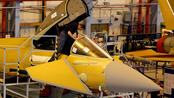 A member of staff works in the cockpit of an aircraft on the Eurofighter Typhoon production line at BAE systems Warton plant near Preston, Britain, September 7, 2012. - Sputnik International