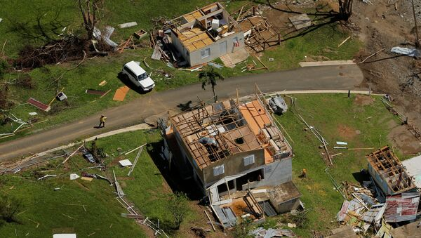Damaged homes are seen as recovery efforts continue following Hurricane Maria near Ciales, Puerto Rico, October 7, 2017 - Sputnik International