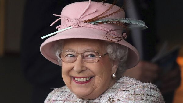 Britain's Queen Elizabeth II smiles as she attends an event at Newbury Racecourse in Newbury England, Friday April 21, 2017. - Sputnik International