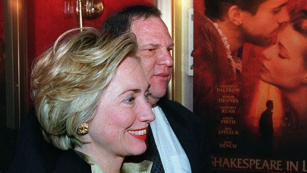 First lady Hillary Rodham Clinton walks with Miramax Co-Chairman Harvey Weinstein into the premier of her new movie Shakespeare in Love, in New York. (File) - Sputnik International