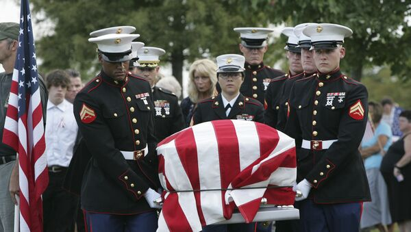 An American flag covers the casket of Lance Cpl. Christopher Fowlkes as it is carried by an honor guard during grave side services Friday, Sept. 18, 2009, in Gaffney, S.C. Fowlkes, 20, died last week from his injuries from a ground bomb on Sept. 3 battle in Helmand province, Afghanistan. - Sputnik International