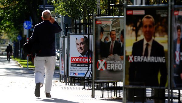 A man walks past an election campaign posters of top candidate of Social Democratic Party of Austria (SPOe) and Austrian Chancellor Christian Kern and far-right Freedom Party of Austria (FPOe) head and top candidate Heinz-Christian Strache in Vienna, Austria, October 5, 2017 - Sputnik International