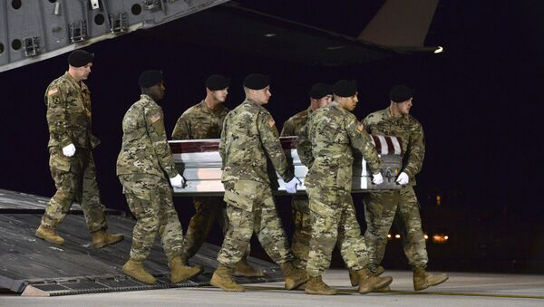 In this image provided by the US Air Force, a US Army carry team transfers the remains of Army Staff Sgt. Dustin Wright of Lyons, Ga., late Thursday, Oct. 5, 2017, upon arrival at Dover Air Force Base, Del. Wright, 29, of Lyons, Ga., was one of four US troops and four Niger forces killed in an ambush by dozens of Islamic extremists on a joint patrol of American and Niger Force. - Sputnik International