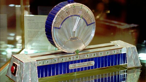 Swiss watch manufacture Piaget with the only model of the Sliding Clock at the 1998 International Fine Watchmaking Exhibition at Geneva, Switzerland. The hours are shown at the base of the clock and the minutes are shown on the disc sliding above the base. The price of these clock, with 926 diamonds (53,27 cts), 50 emeralds (11.63 cts), two rubies, gold weight 930 grams, is some $1.572 million. - Sputnik International