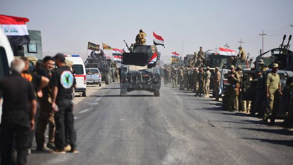 Members of Iraqi federal forces gather to continue to advance in military vehicles in Kirkuk, Iraq - Sputnik International