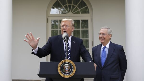 President Donald Trump answers questions with Senate Majority Leader Mitch McConnell, R-Ky., in the Rose Garden after their meeting at the White House, Monday, 16 October 2017, in Washington. - Sputnik International