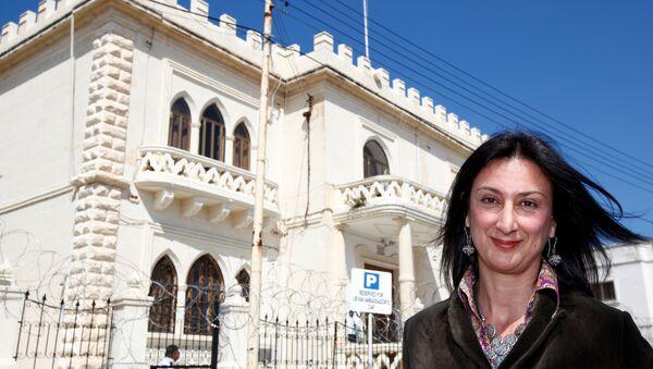 Maltese investigative journalist Daphne Caruana Galizia poses outside the Libyan Embassy in Valletta April 6, 2011. Investigative journalist Caruana Galizia was killed after a powerful bomb blew up a car killing her in Bidnija, Malta, in October 16, 2017. - Sputnik International