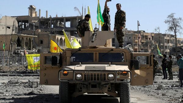 A Fighter of Syrian Democratic Forces takes a selfie as he stands on a military vehicle in Raqqa, Syria October 17, 2017 - Sputnik International