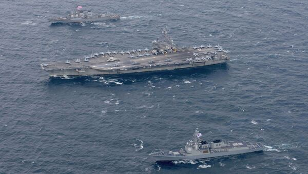 The Navy's forward-deployed aircraft carrier USS Ronald Reagan and the forward-deployed Arleigh Burke-class destroyer USS Stethem steam alongside ships from the Republic of Korea Navy in the waters east of the Korean Peninsula on October 18, 2017 - Sputnik International