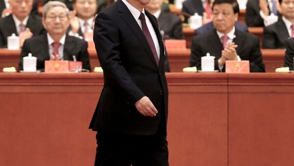 Chinese President Xi Jinping walks to the lectern to deliver his speech during the opening session of the 19th National Congress of the Communist Party of China at the Great Hall of the People in Beijing, China October 18, 2017. - Sputnik International