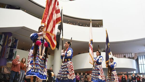 Native American Women Warriors, from left, Takara Matthews (Sokoki Abenaki/Lumbee) Jamie Awonohopay (Menominee), Elizabeth Haas (Northern Arapaho Tribe), Antonia Thomas (Navajo), all veterans of the U.S. Armed Forces, take part in the Presentation of the Colors during a Veterans Day celebration at Smithsonian's National Museum of the American Indian on Friday, Nov. 11, 2016 in Washington - Sputnik International
