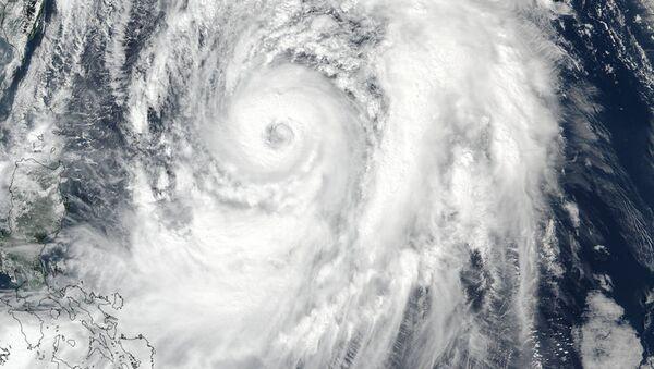 NASA-NOAA Suomi NPP satellite visible light image of Typhoon Lan on October 20 at 12:30 a.m. EDT. - Sputnik International